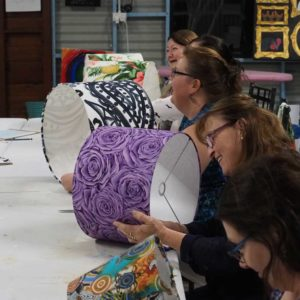 Happy faces at the professional lampshade workshop
