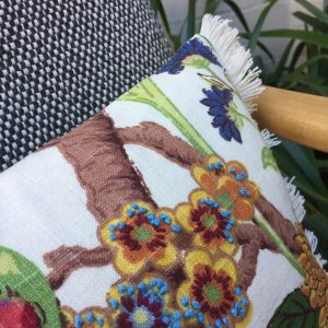Hand embroidered edge trimmed cushion