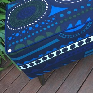 Piped upholstered footstool
